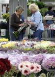 <p>Two women shop for flowers at the Los Angeles Flower Market, May 5, 2008. REUTERS/Alexandria Sage</p>