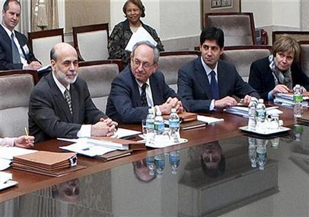 In this file photo Federal Reserve Board Chairman Ben Bernanke (L) chairs a meeting of the Federal Open Market Committee, the Federal Reserve's interest rate-setting body, next to Vice Chairman Donald Kohn (2nd) in Washington in this picture released on March 19, 2009 and taken on March 17. REUTERS/Joe Pavel/Federal Reserve Board/Handout