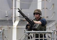 <p>A U.S navy marine stands on guard on the deck of the warship Bainbridge guard upon arrival at the port of Mombasa, 500km from the capital Nairobi, April 16, 2009. NATO forces foiled an attack by Somali pirates on a Norwegian tanker then briefly detained seven gunmen after hunting them down under cover of darkness, NATO officials said on Sunday, April 19. REUTERS/Antony Njuguna</p>