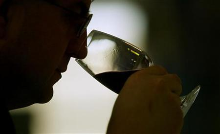 A Bulgarian wine selector tastes red wine from the latest vintage on January 28, 2005, choosing wines for the Vinaria wine fair in Plovdiv. WREUTERS/Stoyan Nenov SN/WS