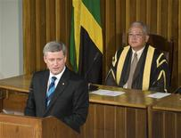 <p>Prime Minister Stephen Harper addresses a joint meeting of Jamaica's Houses of Parliament in Kingston April 20, 2009. Seated behind is Speaker of the House Delroy Chuck. REUTERS/Andrew Smith</p>
