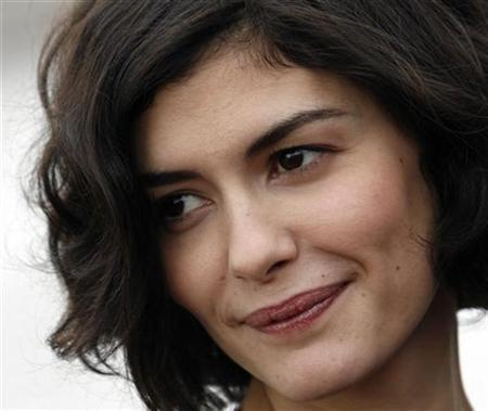 French actress Audrey Tautou poses for photographers in Budapest April 18, 2008. Tautou is in Hungary for the premiere of her film ''Ensemble, c'est tout'' (Hunting and Gathering) during a French film festival. REUTERS/Karoly Arvai