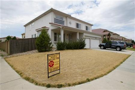 A foreclosed house for sale is pictured in the Green Valley Ranch neighborhood in Denver, Colorado in this July 26, 2007 file photo. REUTERS/Rick Wilking