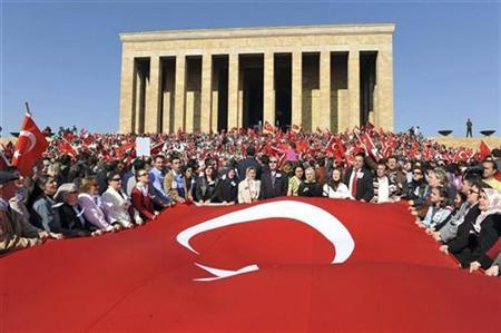 People attend a rally at the mausoleum of Mustafa Kemal Ataturk, the soldier-statesman who founded the secular Turkish republic, in Ankara April 18, 2009. REUTERS/Stringer