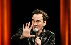 <p>Cineasta norte-americano Quentin Tarantino dando aula de cinema em Cannes. 22/05/2008. REUTERS/Christian Hartmann</p>