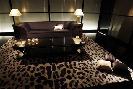 The new Armani Casa collection furniture line is displayed at the Armani store in downtown Milan, April 21, 2009. The International Furnishing and Design exhibition will start on Wednesday and run until April 27. REUTERS/Alessandro Garofalo