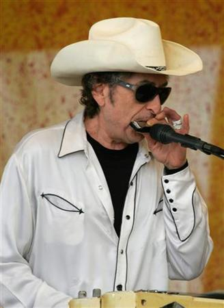 Bob Dylan plays the harmonica at the New Orleans Jazz and Heritage Festival in New Orleans April 28, 2006. REUTERS/Lee Celano