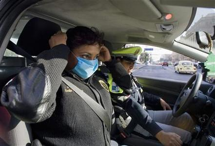 A police woman wears a mask in Mexico City April 24, 2009. REUTERS/Jorge Dan Lopez