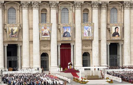 Tapestries depicting five new saints hang from Saint Peter's facade at the Vatican during a canonisation mass led by Pope Benedict XVI April 26, 2009. REUTERS/Alessandro Bianchi