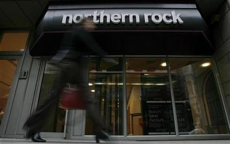 A pedestrian walks past a branch of the Northern Rock bank in the City of London February 23, 2009. REUTERS/Andrew Winning