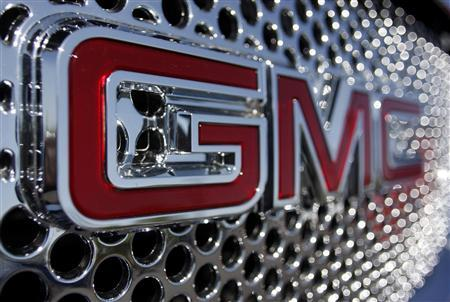 The GMC logo is seen on the grill of car at the Peoria Pontiac GMC car dealership in Peoria, Arizona April, 25 2009. REUTERS/Joshua Lott