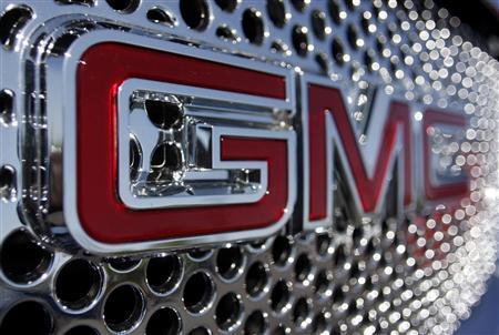 The GMC logo is seen on the grill of car at the Peoria Pontiac GMC car dealership in Peoria, Arizona April, 25 2009. REUTERS/Joshua Lott