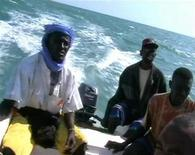 <p>Pirates on a speed boat near the enclave of Eyl, Somalia in a framegrab, November 24, 2008. REUTERS/Reuters TV</p>