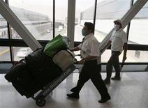 <p>An airport worker wears a surgical mask as he moves the baggage of a tourist at the international airport Benito Juarez in Mexico City April 27, 2009. A new virus has killed up to 149 people in Mexico and the World Health Organization moved closer on Monday to declaring it the first flu pandemic in 40 years as more people were infected in the United States and Europe. The WHO raised its pandemic alert level for the swine flu virus to phase 4, indicating a significantly increased risk of a pandemic, a global outbreak of a serious disease. REUTERS/Henry Romero</p>
