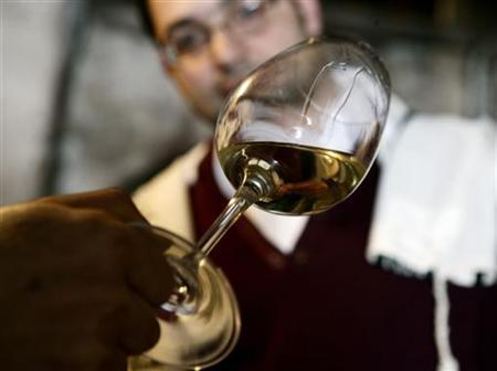 Rabbi Yair Didi, who supervises production of kosher wines at the 'Cantina di Pitigliano' winery, samples a glass in the Tuscan town of Pitigliano March 26, 2007. Picture taken March 26, 2007. REUTERS/Daniele La Monaca