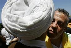<p>Nissim Nasser (R) kisses Hezbollah senior official Sheikh Nabil Qawouk upon his arrival at Naqoura village in south Lebanon June 1, 2008. Lebanese should stop greeting each other with kisses to the cheek, Health Minister Mohammad Khalifeh told a news conference on Tuesday called to explain measures to tackle the potential spread of the deadly strain. REUTERS/Ali Hashisho</p>