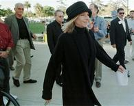 <p>Entertainer Barbara Streisand walks to the podium as her husband James Brolin (L) watches at an anti-impeachment rally sponsored by The People for the American Way at the Federal Building December 16 in Westwood in this file photo from 1998. SSM/ME</p>