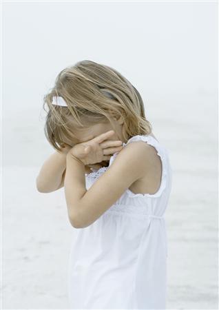 A girl cries on a beach in a handout photo. REUTERS/Newscom