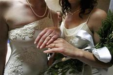<p>Sharon Papo (R) and her partner Amber Weiss display their wedding rings after exchanging wedding vows at City Hall on the first full day of legal same-sex marriages in San Francisco, California June 17, 2008. REUTERS/Erin Siegal</p>