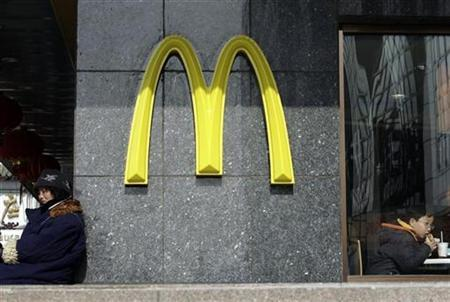 A child eats a hamburger at a McDonald's outlet in Beijing in this file photo from February 5, 2009.REUTERS/Jason Lee