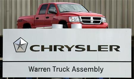 A Chrysler Warren Truck Assembly sign is seen in front of the auto plant with a Dodge Ram pick-up truck on display in Warren, Michigan April 29, 2009. REUTERS/Rebecca Cook