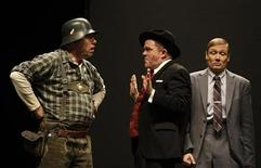 <p>Herbert Steinboeck (L-R), Cornelius Obonya and Andreas Bieber act as Franz Liebkind, Max Bialystock and Leo Bloom during a dress rehearsal to promote the musical 'The Producers - Fruehling fuer Hitler' (The Producers - Autumn for Hitler) in Berlin, December 11, 2008. REUTERS/Tobias Schwarz</p>