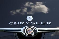 <p>Clouds are reflected on a Chrysler PT Cruiser at a Chrysler dealership in Rome April 30, 2009. REUTERS/Tony Gentile</p>