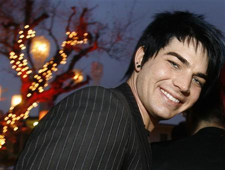 Adam Lambert, one of the top four finalists of the television show ''American Idol,'' poses at the BritWeek 2009 party in Los Angeles April 23, 2009. REUTERS/Mario Anzuoni