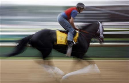 Kentucky Derby favourite I Want Revenge gallops with exercise rider Joe Deggan during early morning workouts at Churchill Downs in Louisville, Kentucky, April 30, 2009. Wood Memorial winner I Want Revenge drew the 13th post on Wednesday and has been installed as the early 3-1 favourite for Saturday's Kentucky Derby. REUTERS/Jeff Haynes