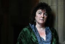 <p>Britain's new poet laureate Carol Ann Duffy poses for photographers following a news conference at the John Rylands library in Manchester in Manchester, northern England, May 1, 2009. Duffy is the first woman to hold the royal post in its 341-year history. REUTERS/Phil Noble</p>