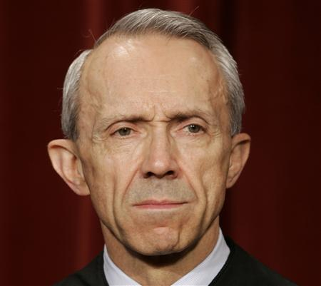 Supreme Court Justice David Souter poses for an official picture with other justices at the Supreme Court, October 31, 2005. REUTERS/Jason Reed