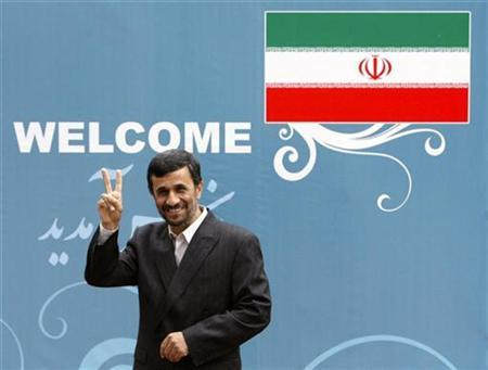 Iran's President Mahmoud Ahmadinejad flashes a victory sign while attending an official welcoming ceremony for his Armenian counterpart Serzh Sarksyan in Tehran, April 13, 2009. REUTERS/Morteza Nikoubazl