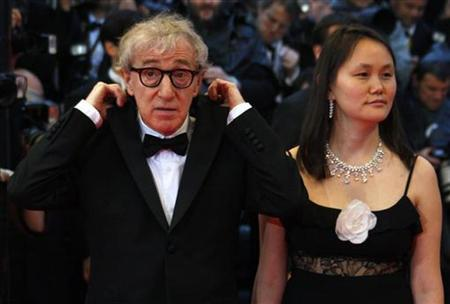 U.S. director Woody Allen and his wife Soon-Yi arrive for the screening of his film ''Vicky Cristina Barcelona'' at the 61st Cannes Film Festival, May 17, 2008. REUTERS/Jean-Paul Pelissier