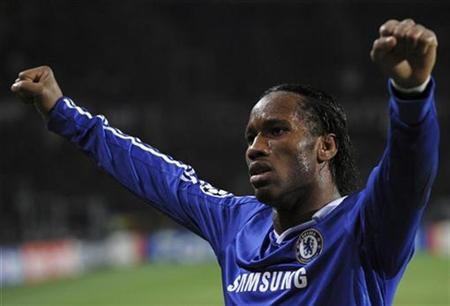 Chelsea Didier Drogba celebrates at the end of their Champions League soccer match against Juventus at the Olympic stadium in Turin March 10, 2009. REUTERS/ Alessandro Bianchi