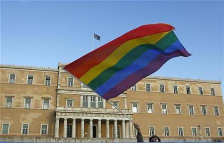A protestor waves a rainbow flag during a gay protest outside the Greek parliament in Athens September 29, 2008. REUTERS/Yiorgos Karahalis