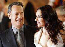 """<p>Actor Tom Hanks and Israeli actress Ayelet Zurer (R) arrive at the world premiere of the movie """"Angels & Demons"""" in Rome May 4, 2009. REUTERS/Tony Gentile</p>"""