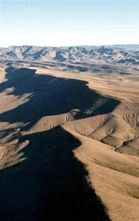 An aerial view of the remote Nevada site of Yucca Mountain in Nevada is seen in this undated handout photo. REUTERS/Dept Of Energy-Handout RC/HB