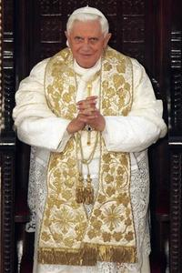Pope Benedict XVI attends mass at Saint George Victorious Cathedral in Amman May 9, 2009. REUTERS/Muhammad Hamed