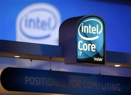 Signs at the Intel booth refer to the recently released Core i7 chip at the annual Consumer Electronics Show (CES) in Las Vegas, Nevada January 9, 2009. REUTERS/Rick Wilking