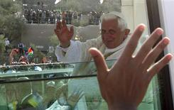 <p>Pope Benedict XVI waves at the crowd from his Popemobile as he arrives to lead a mass at the Garden of Gethsemane at the foot of the Mount of Olives in Jerusalem May 12, 2009, where it is believed Jesus had his final prayer before he was betrayed and arrested. REUTERS/Yannis Behrakis</p>