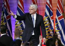 <p>British Columbia Premier Gordon Campbell greets supporters at his election night headquarters after winning his third straight provincial election in Vancouver, British Columbia May 12, 2009. REUTERS/Andy Clark</p>