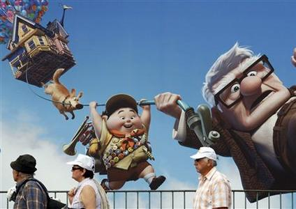 People walk past a giant advertising board for the animated film ''Up'', directed by Pete Docter, in front of the Carlton Hotel in Cannes on the eve of the 62nd Cannes film Festival, May 12, 2009. REUTERS/Regis Duvignau