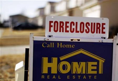 The sign for a foreclosed house for sale sits at the property in Denver, March 4, 2009. REUTERS/Rick Wilking