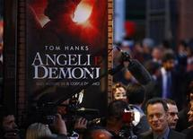 "<p>Actor Tom Hanks gives interviews as he arrives at the world premiere of the movie ""Angels & Demons"" at the Auditorium in Rome May 4, 2009. REUTERS/Alessia Pierdomenico</p>"