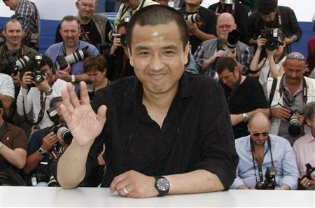 Director Lou Ye poses during a photocall for his film ''Chun Feng Chen Zui De Ye Wan'' (Spring Fever), at the 62nd Cannes Film Festival May 14, 2009. REUTERS/Eric Gaillard
