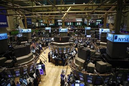 Traders work at the New York Stock Exchange, March 27, 2009. REUTERS/Eric Thayer