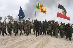 """<p>Soldati srilankesi ieri nella cosiddetta """"No Fire Zone"""". REUTERS/Sri Lankan Government/Handout</p>"""