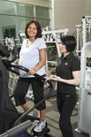 <p>ACE personal trainer Sabrena Merril and client Camisha Burks-Walker in San Diego, California are seen in this undated handout photo. REUTERS/American Council on Exercise (ACE)</p>