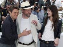 "<p>Director Lars Von Trier (C) poses with cast member Charlotte Gainsbourg (R) and Willem Dafoe (L) during a photocall for the film ""Antichrist"" at the 62nd Cannes Film Festival May 18, 2009. Twenty films compete for the prestigious Palme d'Or which will be awarded on May 24. REUTERS/Regis Duvignau</p>"