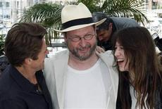 "<p>Director Lars Von Trier (C) poses with cast members Charlotte Gainsbourg (R) and Willem Dafoe (L) during a photocall for the film ""Antichrist"" at the 62nd Cannes Film Festival May 18, 2009. REUTERS/Regis Duvignau</p>"